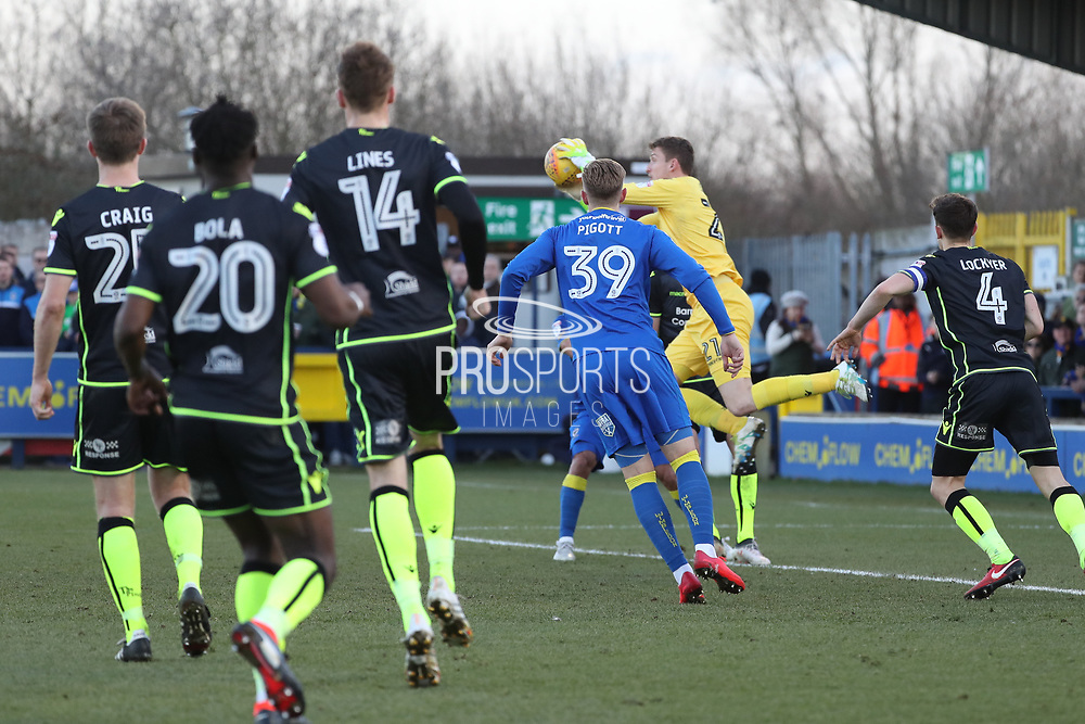 Bristol Rovers goalkeeper Adam Smith (21) saving from AFC Wimbledon striker Joe Pigott (39) during the EFL Sky Bet League 1 match between AFC Wimbledon and Bristol Rovers at the Cherry Red Records Stadium, Kingston, England on 17 February 2018. Picture by Matthew Redman.