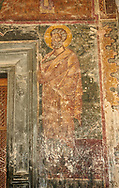 Pictures & images of the medieval fresco of saints on the front door of the Alaverdi St George Cathedral & monastery complex, 11th century, near Telavi, Georgia (country). <br /> <br /> At 50 meters high Alaverdi St George Cathedral was once the highest cathedral in Georgia (now its the nes Tblisi cathedral). The cathedral is part of a Georgian Orthodox monastery founded by the monk Joseph [Abba] Alaverdeli, who came from Antioch and settled in Alaverdi. On the UNESCO World Heritage Site Tentative List. .<br /> <br /> Visit our MEDIEVAL PHOTO COLLECTIONS for more   photos  to download or buy as prints https://funkystock.photoshelter.com/gallery-collection/Medieval-Middle-Ages-Historic-Places-Arcaeological-Sites-Pictures-Images-of/C0000B5ZA54_WD0s .<br /> <br /> Visit our REPUBLIC of GEORGIA HISTORIC PLACES PHOTO COLLECTIONS for more photos to browse, download or buy as wall art prints https://funkystock.photoshelter.com/gallery-collection/Pictures-Images-of-Georgia-Country-Historic-Landmark-Places-Museum-Antiquities/C0000c1oD9eVkh9c