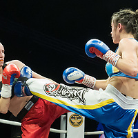 Renata Rakoczi (L) of Hungary and Antonina Osetska (R) of Ukraine fight during the WAKO  women's kick-boxing 55kg World Championship Final in Budapest, Hungary on Nov. 16, 2019. ATTILA VOLGYI
