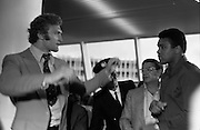 Muhammad Ali In Dublin..1972..11.07.1972..07.11.1972..11th July 1972..Prior to his fight against Al 'Blue' Lewis at Croke Park ,Dublin, former World Heavyweight Champion,Muhammad Ali arrives at Dublin Airport..The fight was part of his build up for for a championship fight against the current World Champion, 'Smokin'  Joe Frazier. Ali had been stripped of the title partly due to his refusal to join the American military during The Vietnam War,which he had opposed...Image of  Muhammad Ali  and Joe Bugner as they 'throw a few shapes' for the cameramen.