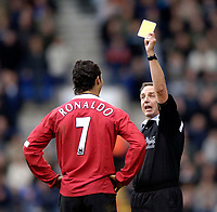 Photo: Jed Wee.<br />Bolton Wanderers v Manchester United. The Barclays Premiership. 01/04/2006.<br />Referee Alan Wiley shows Manchester United's Cristiano Ronaldo the yellow card.