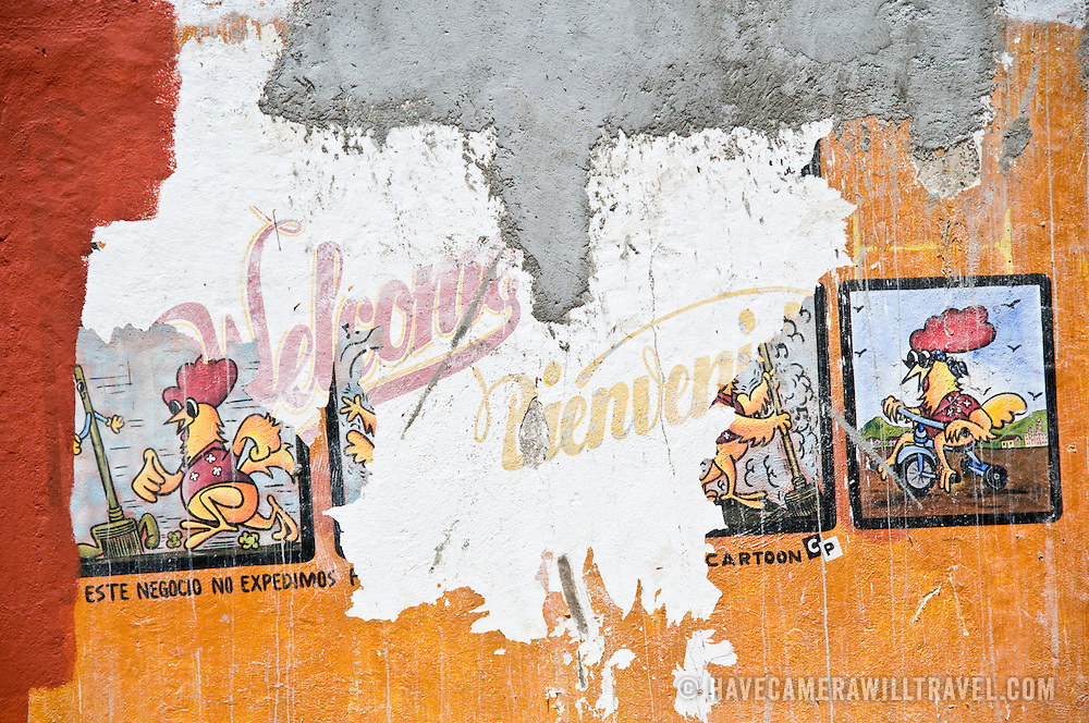 Painting on shop wall of chickens on fire