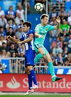 Deportivo Alaves' Manu Garcia (l) and FC Barcelona's Ivan Rakitic during La Liga match. August 26,2017. (ALTERPHOTOS/Acero)