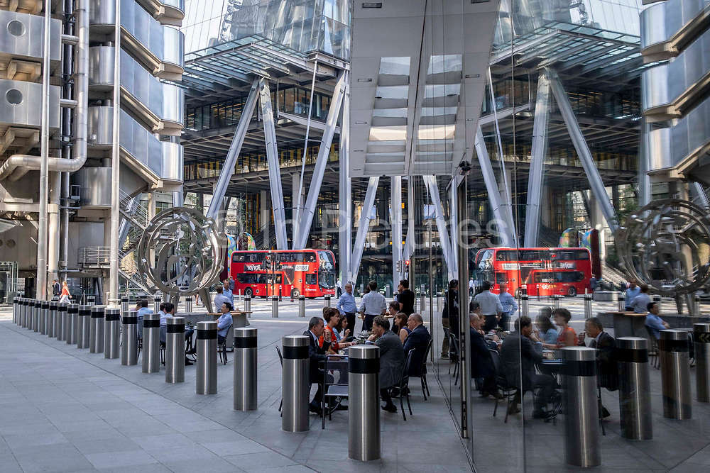 In the week that many more Londoners returned to their office workplaces after the Covid pandemic, businesspeople gather to enjoy after-hours drinks beneath the Lloyds Building left and other modern skyscrapers on Leadenhall in the City of London, the capitals financial district, on 8th September 2021, in London, England.