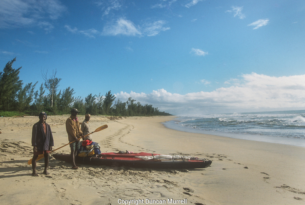 I tried to re-launch my kayak with the help of my local friends but every time I jumped into the kayak and tried to paddle out through the surf my kayak was swung around and I capsized, with my head getting rubbed into the sand. We eventually gave up and I made plans to be collected by a taxi and driven north to somewhere with more protection. My fully loaded, heavy kayak just wasn't suitable for getting out through heavy surf and that was going to be a major limiting factor for the rest of my journey.