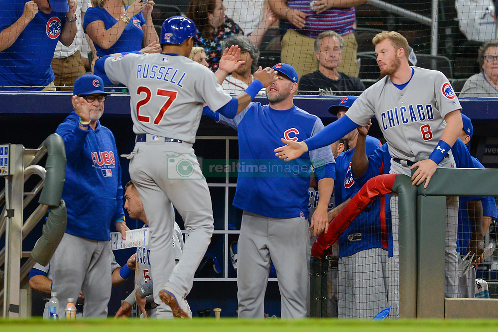 May 15, 2018 - Atlanta, GA, U.S. - ATLANTA, GA Ð MAY 15:  Cubs infielder Addison Russell (27) is congratulated by the Cubs bench after scoring the go-ahed run in the top of the 9th inning during the game between Atlanta and Chicago on May 15th, 2018 at SunTrust Park in Atlanta, GA. The Chicago Cubs defeated the Atlanta Braves by a score of 3 -2.  (Photo by Rich von Biberstein/Icon Sportswire) (Credit Image: © Rich Von Biberstein/Icon SMI via ZUMA Press)