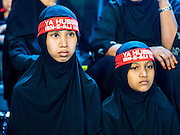 23 OCTOBER 2015 - YANGON, MYANMAR: Shia girls wait to participate in an Ashura procession at Mogul Mosque in Yangon. Ashura commemorates the death of Hussein ibn Ali, the grandson of the Prophet Muhammed, in the 7th century. Hussein ibn Ali is considered by Shia Muslims to be the third imam and the rightful successor of Muhammed. He was killed at the Battle of Karbala in 610 CE on the 10th day of Muharram, the first month of the Islamic calendar. According to Myanmar government statistics, only about 4% of the population is Muslim. Many Muslims have fled Myanmar in recent years because of violence directed against Burmese Muslims by Buddhist nationalists. PHOTO BY JACK KURTZ