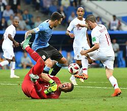SOCHI, June 30, 2018  Goalkeeper Fernando Muslera (bottom) of Uruguay competes during the 2018 FIFA World Cup round of 16 match between Uruguay and Portugal in Sochi, Russia, on June 30, 2018. Uruguay won 2-1 and advanced to the quarter-final. (Credit Image: © Liu Dawei/Xinhua via ZUMA Wire)