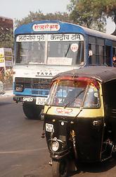 Auto rickshaw and bus on Delhi street; India,
