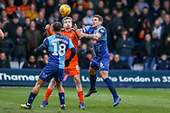 Wycombe Wanderers defender Adam El-Abd and Luton Town midfielder Luke Berry scrap for the ball during the EFL Sky Bet League 1 match between Luton Town and Wycombe Wanderers at Kenilworth Road, Luton, England on 9 February 2019.