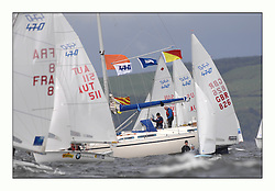 470 Class European Championships Largs - Day 3.Brighter conditions with more wind...Flags, Blaise, Committee Vessel,