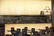 Chefs inside Carluccio's retail restaurant in landside Departures area of London Heathrow Airport's Terminal 5 building.