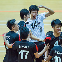 Chong Xuan Li (#14) of Nanyang Junior College reacts after the 3-1 victory over Victoria Junior College in the final of the National 'A' Division Volleyball Championship at Toa Payoh Sports Hall on May 14, 2014, in Singapore.