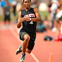 051813  Adron Gardner/Independent<br /> <br /> Grants Pirate Cassius Corley takes his second step in his final triple jump attempt at University Stadium in Albuquerque Friday.   Corley finished in second place to Kale Brown of Albuquerque Academy.