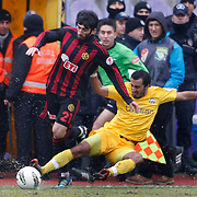 Eskisehirspor's Burhan Eser (L) during their Turkey Cup matchday 3 soccer match Eyupspor between Eskisehirspor at Eyup Stadium in Istanbul Turkey on Wednesday, 11 January 2012. Photo by TURKPIX