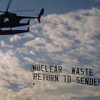 Helicopter from MV GREENPEACE pulling a banner protesting at the carriage of Japanese spent nuclear fuel by PACIFIC PINTAIL in the Irish Sea en route to Sellafield reprocessing plant via Barrow, Cumbria.  Accession #: 0.90.141.001.16