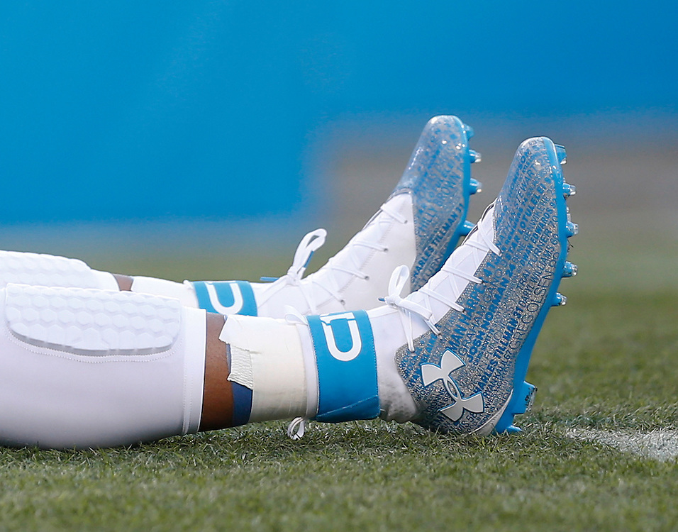 CHARLOTTE, NC - JAN 24:  Cam Newton #1 of the Carolina Panthers warms up in spikes with the names of all hist teammates before the NFC Championship game against the Arizona Cardinals at Bank of America Stadium on January 24, 2016 in Charlotte, North Carolina.