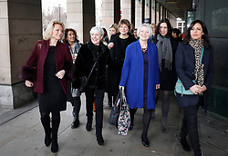 © Licensed to London News Pictures. 31/01/2018. London, UK. Members of the BBC Women's Group including Sonja Mclaughlan, Kasia Madera, Louise Minchin, Naga Munchetty, Mariella Frostrup, Kate Adie and Kate Silverton stand with others ahead of the arrival of former China editor for BBC News, CARRIE GRACIE, at Portcullis House in London before she gives evidence to the Digital, Culture, Media and Sport Committee on the ongoing row over equal pay at the BBC. A recent review found 'no gender bias in on-air pay decisions' at the BBC, however, the same report found a found a 6. 8% gender pay gap among on-air staff. Photo credit: Peter Macdiarmid/LNP