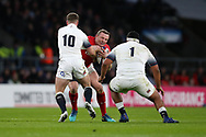 Hadleigh Parkes of Wales is stopped by George Ford (10) and Mako Vunipola of England (1).England v Wales, NatWest 6 nations 2018 championship match at Twickenham Stadium in Middlesex, England on Saturday 10th February 2018.<br /> pic by Andrew Orchard, Andrew Orchard sports photography