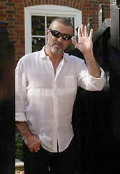 File photo dated 11/10/10 of George Michael outside his house in Highgate, north London, after being released from prison, as the pop superstar has died peacefully at home, his publicist said.