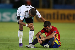Germany's Jeremy Toljan (left) consoles Spain's Dani Ceballos after the final whistle