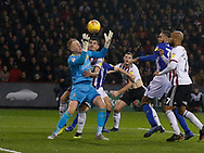 Sheffield Wednesday goalkeeper Cameron Dawson (25) holds the ball under pressure during the EFL Sky Bet Championship match between Sheffield United and Sheffield Wednesday at Bramall Lane, Sheffield, England on 9 November 2018.