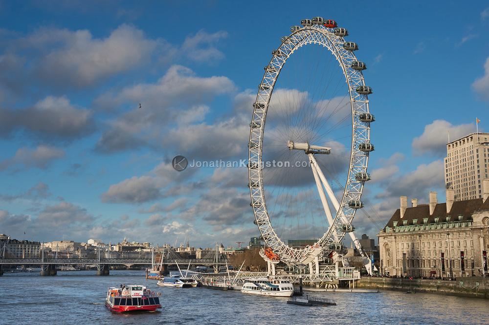 London Eye, also known as the Millennium Wheel, with the River Thames, the Golden Jubilee Bridges and County Hall visible in London, England.