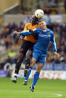 Fotball<br /> England 2004/2005<br /> Foto: SBI/Digitalsport<br /> NORWAY ONLY<br /> <br /> Wolverhampton Wanderers v Cardiff City<br /> The League Championship. 25/09/2004<br /> <br /> Seyi George Olofinjana of Wolves goes up for an aerial ball with Willie Boland of Cardiff