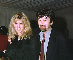 TREVOR NUNN and his wife actress IMOGEN STUBBS at a party in London on October 21st 1997.MCI 60