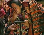 Women cry while watching a picture from 2005 of Saidol, on Matthieu Paley's phone. Forty days after the death of Saidol, the former mayor, a ceremony is celebrated in his honor. The traditional life of the Wakhi people, in the Wakhan corridor, amongst the Pamir mountains.