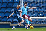 Iain Davidson (#4) of Raith Rovers FC tackles John Souttar (#4) of Heart of Midlothian FC during the SPFL Championship match between Raith Rovers and Heart of Midlothian at Stark's Park, Kirkcaldy, Scotland on 30 April 2021.