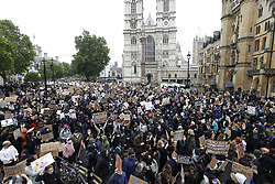 © Licensed to London News Pictures. 06/06/2020. London, UK.  Protesters move past Westminster Abbey during a Black Lives Matter demonstration over the killing of African American George Floyd. The death of George Floyd, who died after being restrained by a police officer In Minneapolis, Minnesota, caused widespread rioting and looting across the USA. Photo credit: Peter Macdiarmid/LNP
