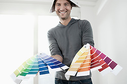 Man showing colour samples and smiling, Bavaria, Germany