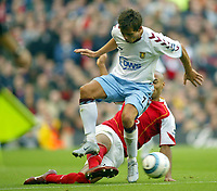 16/10/2004<br />FA Barclays Premiership - Arsenal v Aston Villa - HIghbury<br />Arsenal's Thierry Henry goes through the back of Aston Villa's Lee Hendrie<br />Photo:Jed Leicester/BPI (back page images)
