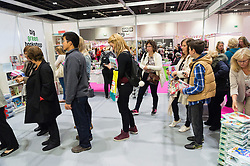 © Licensed to London News Pictures. 07/10/2016. Customers queue up to have their books signed by NADIYA JAMIR HUSSAIN, winner of the BBC TV series The Great British Bake Off in 2015.  NADIYA took part in a baking demonstration at The Cake & Bake Show. London, UK. Photo credit: Ray Tang/LNP