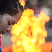 090314  Adron Gardner<br /> <br /> McKeon Dempsey prepares a fire to cook for the Miss Navajo fry bread competition at the Navajo Nation Fairgrounds in Window Rock Wednesday.