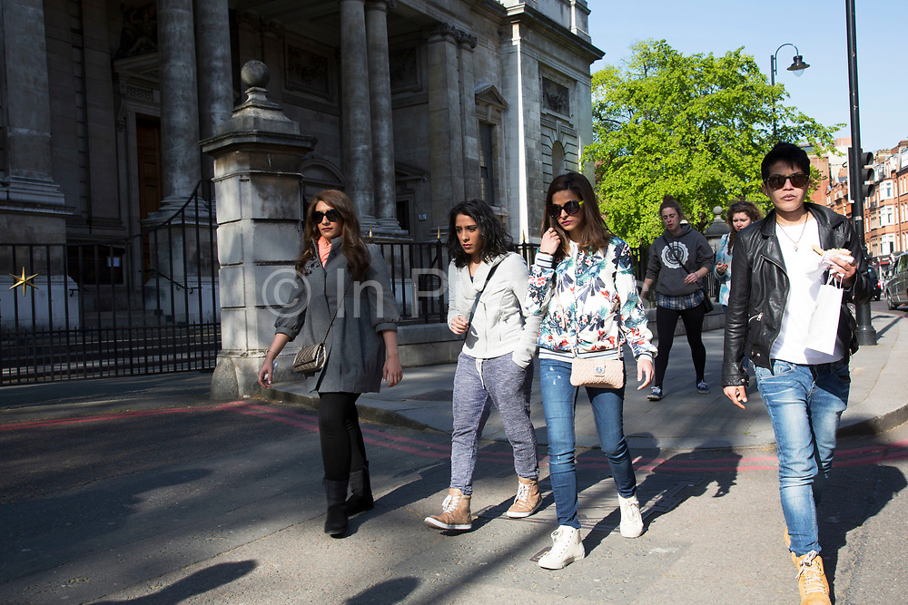 Middle Eastern women in South Kensington. In a selected few boroughs of West London, wealth has changed over the last couple of decades. Traditionally wealthy parts of town, have developed into new affluent playgrounds of the super rich. With influxes of foreign money in particular from the Middle-East. The UK capital is home to more multimillionaires than any other city in the world according to recent figures. Boasting a staggering 4,224 'ultra-high net worth' residents - people with a net worth of more than $30million, or £19.2million.. London, England, UK.