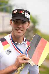 Third placed Germany's Marcel Hacker at medal ceremony in finish area after Men's Single Sculls  final A at Rowing World Cup  on May 30, 2010, at Bled's lake in Zaka, Bled, Slovenia. (Photo by Vid Ponikvar / Sportida)