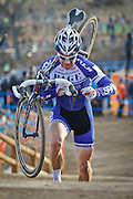 SHOT 1/12/14 4:37:35 PM - Jonathan Page (#1) of Northfield, N.H.  shoulders his bike on the 5280' Run Up section in the Men's Elite race at the 2014 USA Cycling Cyclo-Cross National Championships at Valmont Bike Park in Boulder, Co. Page finished sixth in the race. (Photo by Marc Piscotty / © 2014)