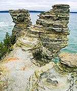 Sedimentary rock eroded into the landmark of Miners Castle at Pictured Rocks National Lakeshore, Upper Peninsula, Michigan, USA.