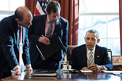 President Barack Obama works with Ben Rhodes, Deputy National Security Advisor for Strategic Communications, left, and Terry Szuplat, Senior Director for Speechwriting, on remarks in the Oval Office prior to the White House Summit on Countering Violent Extremism, Feb. 18, 2015. (Official White House Photo by Pete Souza)<br /> <br /> This official White House photograph is being made available only for publication by news organizations and/or for personal use printing by the subject(s) of the photograph. The photograph may not be manipulated in any way and may not be used in commercial or political materials, advertisements, emails, products, promotions that in any way suggests approval or endorsement of the President, the First Family, or the White House.