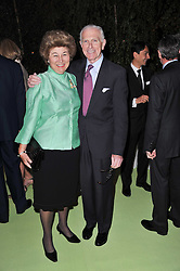 The HON.SIR DAVID & LADY SIEFF at a dinner hosted by Cartier in celebration of the Chelsea Flower Show held at Battersea Power Station, 188 Kirtling Street, London SW8 on 23rd May 2011.