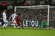 Lukasz Fabianski , the Swansea city goalkeeper watches the ball go past his post as Mohamed Salah of Liverpool © closes in. Premier league match, Swansea city v Liverpool at the Liberty Stadium in Swansea, South Wales on Monday 22nd January 2018. <br /> pic by  Andrew Orchard, Andrew Orchard sports photography.