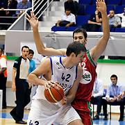 Anadolu Efes's Stanko BARAC (L) during their Turkey Cup Qualifying basketball second match Anadolu Efes between Pinar Karsiyaka at Aliaga Arena in Izmir, Turkey, Monday, October 10, 2011. Photo by TURKPIX