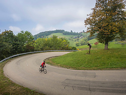 Man riding racing bicycle on cycling tour in the Southern Black Forest, Baden-Wuerttemberg, Germany