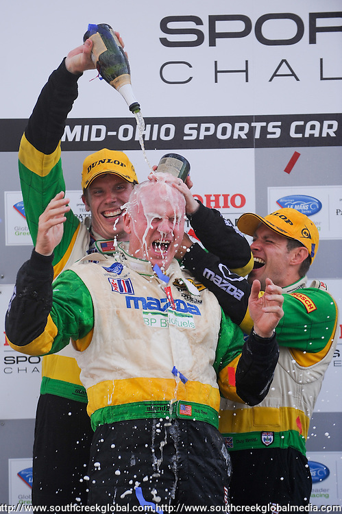 7 August, 2010; CHRIS DYSON (left) and GUY SMITH (right) douse carowner ROB DYSON (center) with champagne to celebrate their overall and LMP victory in the American LeMans Series Mid-Ohio Sports Car Challenge at the Mid-Ohio Sports Car Course in Lexington, Ohio..Mandatory Credit: Will Schneekloth / Southcreek Global
