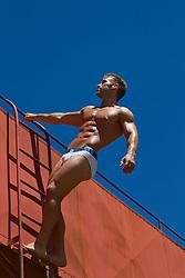 male underwear model posing on a ladder outdoors