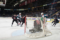 KELOWNA, CANADA - JANUARY 16:  Brodan Salmond #30 of the Moose Jaw Warriors defends the net during third period and makes a save on a shot by Leif Mattson #28 of the Kelowna Rockets on January 16, 2019 at Prospera Place in Kelowna, British Columbia, Canada.  (Photo by Marissa Baecker/Shoot the Breeze)