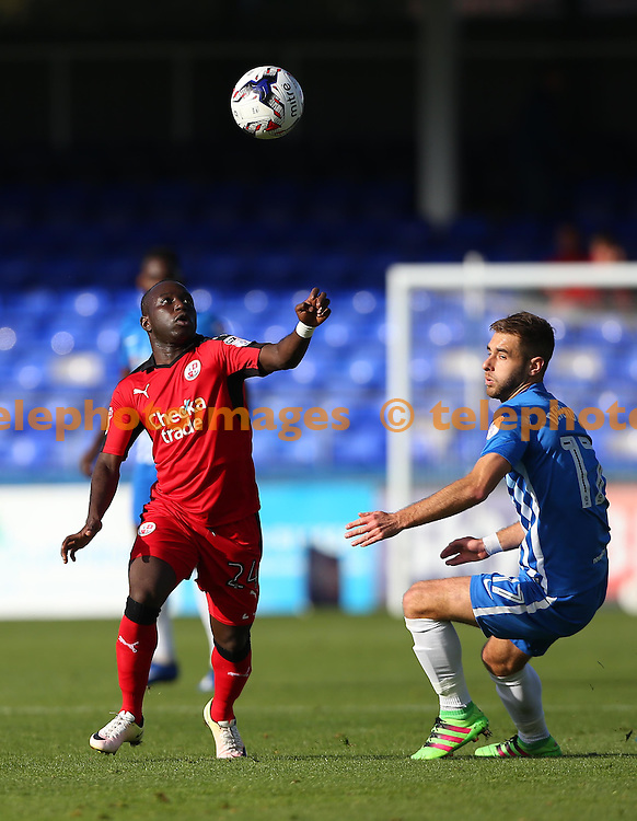 Crawley's Aliu Kaby Djalo keeps his eye on the ball as Nicky Deverdics of Hartlepool looks on during the Sky Bet League 2 match between Hartlepool United and Crawley Town at Victoria Park in Hartlepool. October 8, 2016.<br /> James Boardman / Telephoto Images<br /> +44 7967 642437