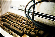 Abandoned typewriter covered in dust